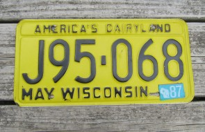 Wisconsin America's Dairyland Yellow License Plate 1984
