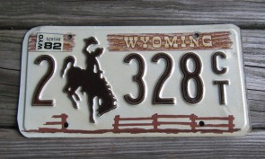 Wyoming Brown Wooden Fence License Plate Bucking Horse 1982