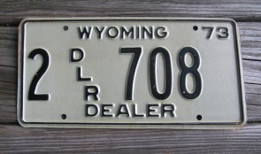 Wyoming Brown White Dealer License Plate 1973